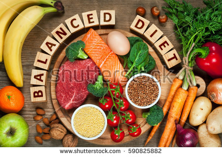 stock-photo-balanced-diet-healthy-food-on-wooden-table-590825882
