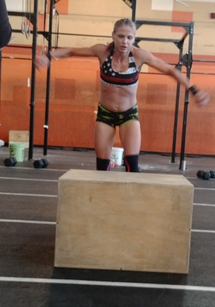 CrossFit hotties at CrossFit Competition doing box jumps