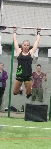 crossfit girls doing chest to bar pull ups at crossfit competition