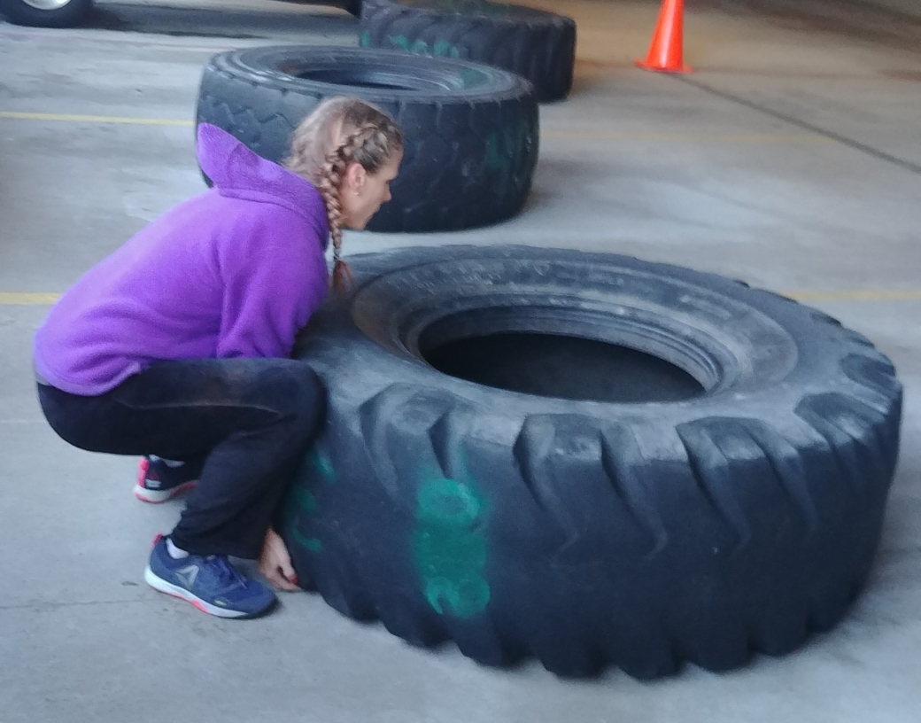 hot crossfit chicks flipping tires at CrossFit Competiton