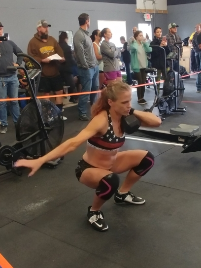 crossfit girls at a crossfit competition doing dumbbell front squats