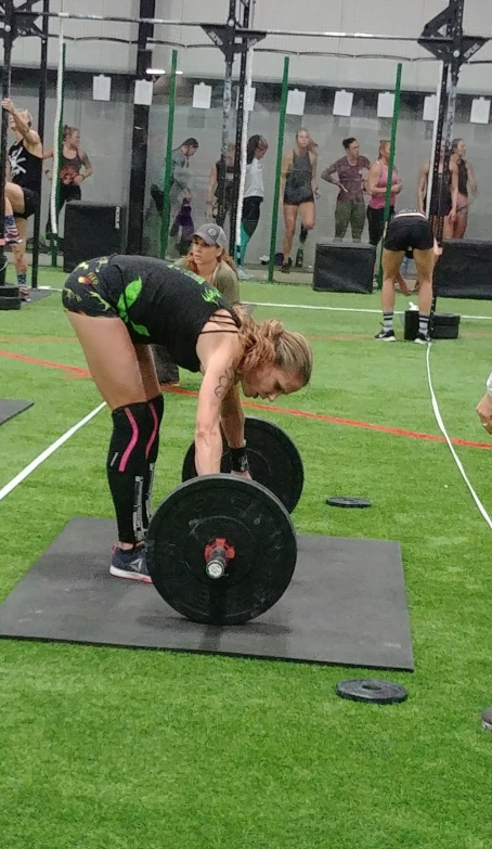 Crossfit chicks preparing to weightlift in CrossFit