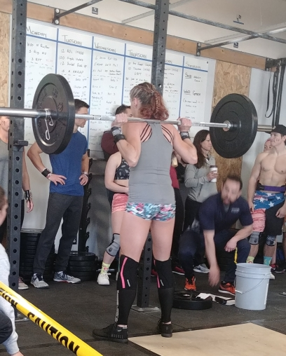 crossfit hotties doing back squats at a crossfit competition in windsor, co