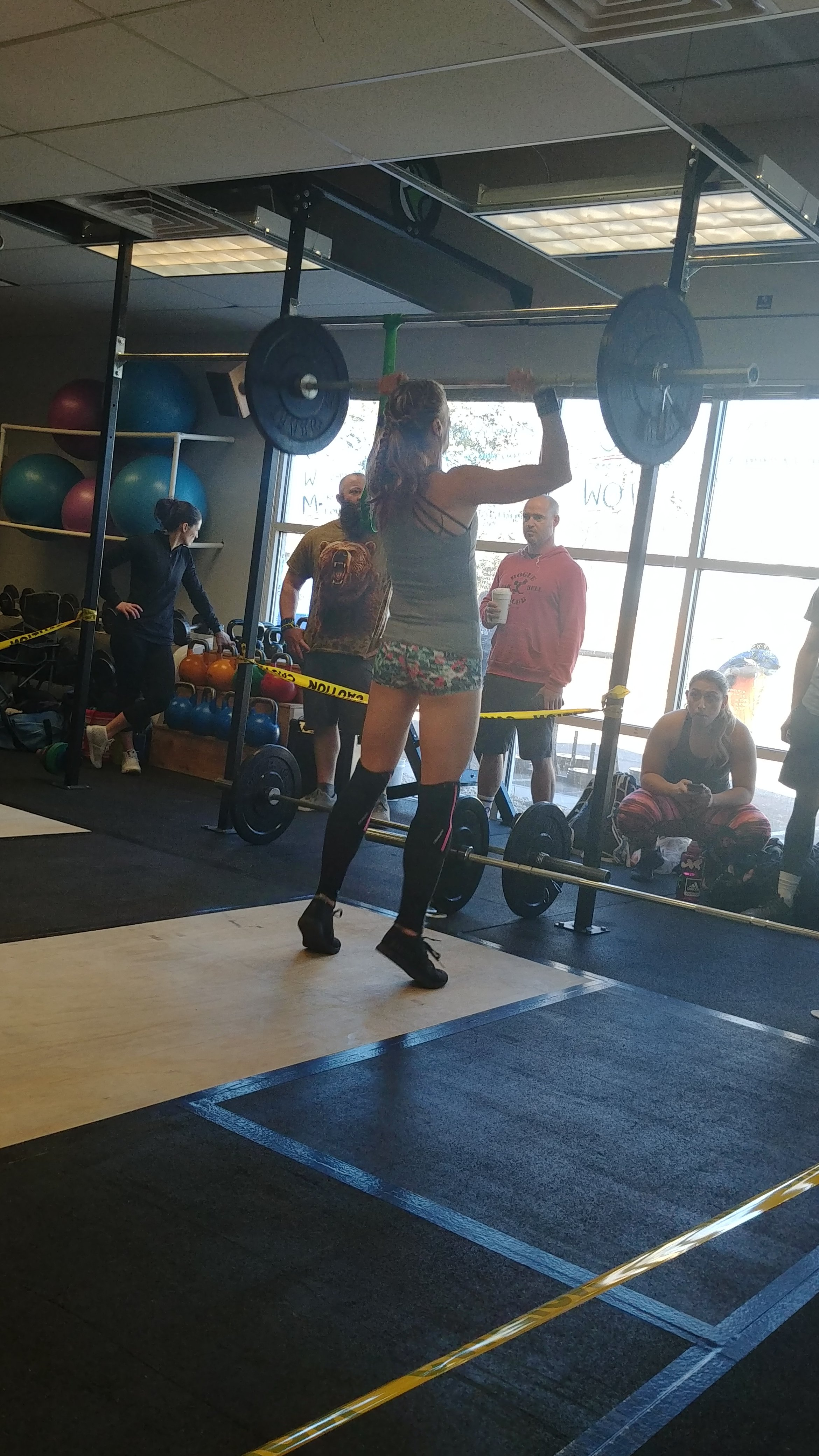 crossfit girls doing crossfit push press in crossfit competition in Windsor, CO