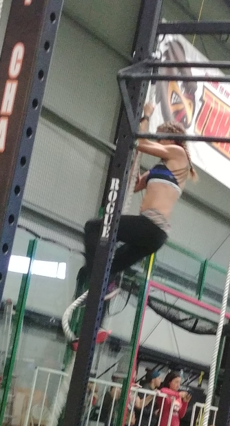 Hot crossfit girls Climbing Rope in CrossFit Competition in Denver, CO