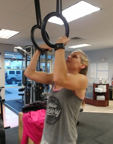 Practicing Ring Muscle Ups CrossFit hot crossfit chick in Colorado