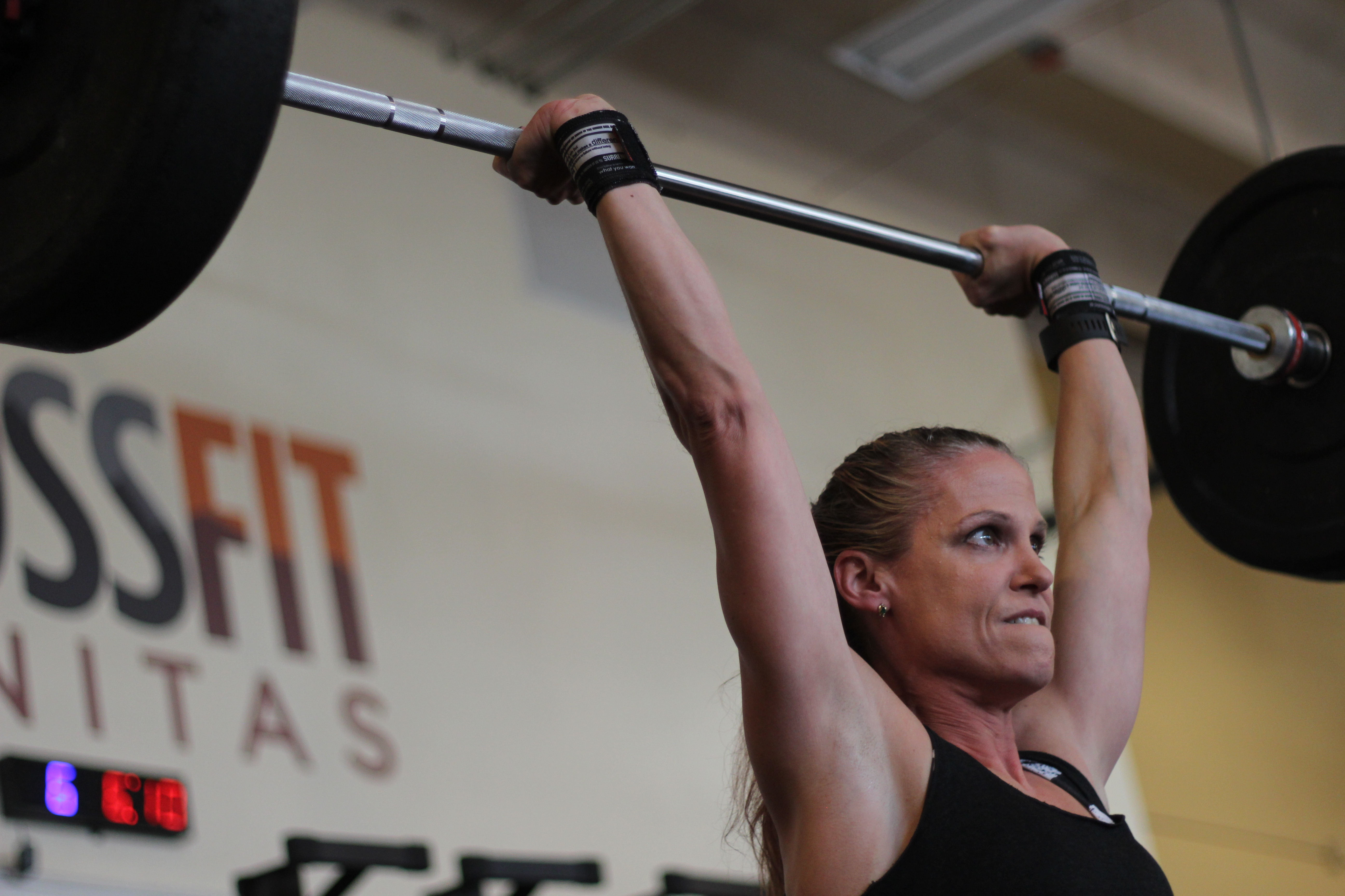 hot crossfit chicks at a crossfit competition doing crossfit clean and jerks at crossfit sanitas in boulder, co