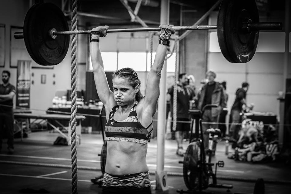 hot crossfit chick doing crossfit competition clean and jerk in denver