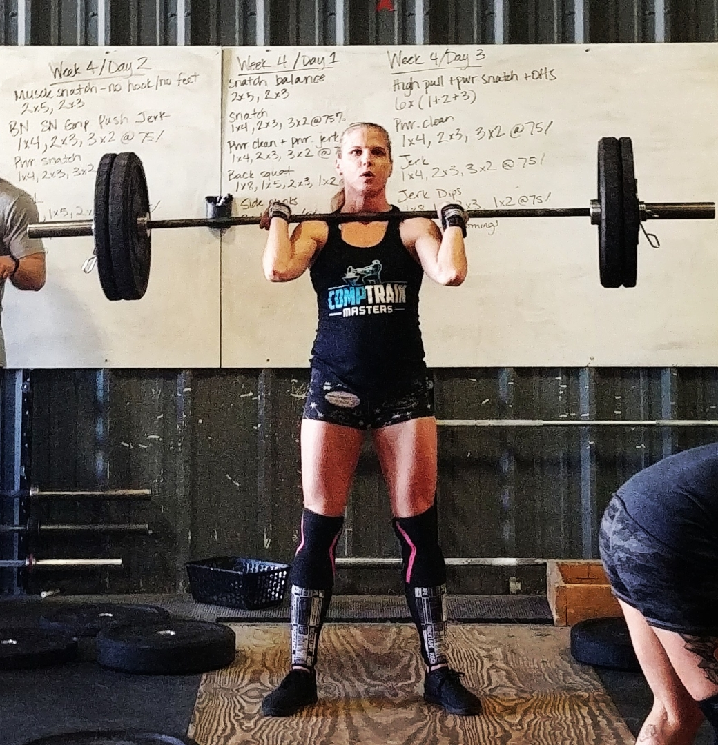 Hotcrossfitchick doing thrusters at crossfit competition in colorado springs
