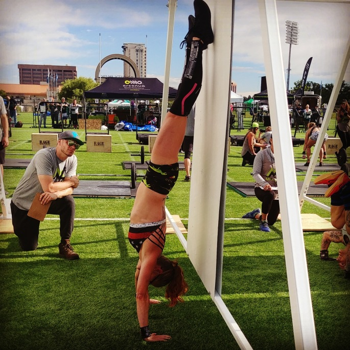 hot crossfit chick doing Handstand Push Ups at CrossFit Competition in Colorado