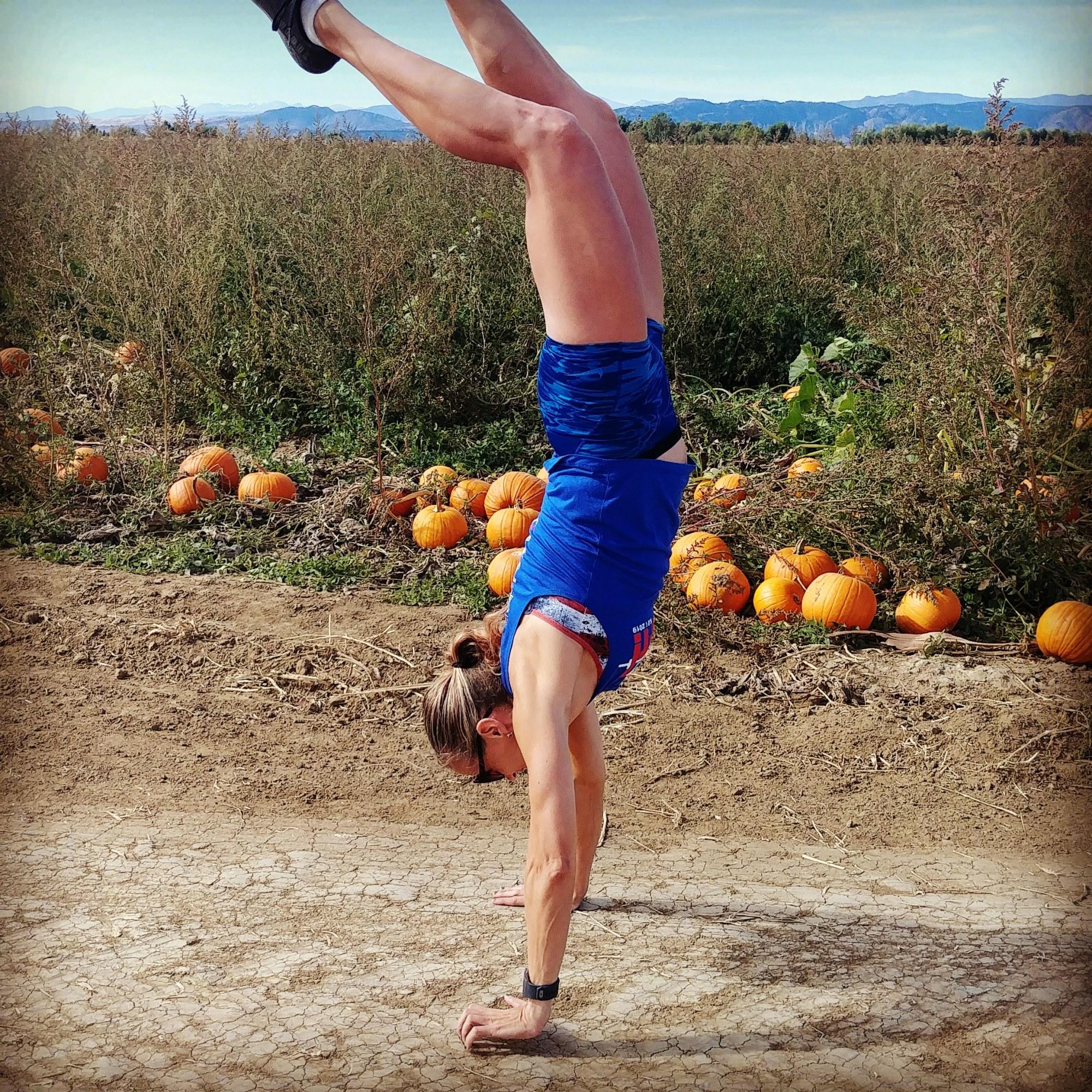 hot crossfit mom doing handstands in pumpkin patch northern colorado